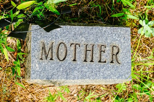 Mother Engraved on a Granite Grave Marker in a Cemetery