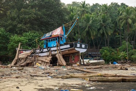 An old wooden fishing boat, now it home to locals, Goa, India