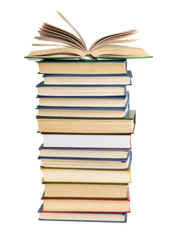 stack of various books, on top an open book, items are isolated on white background, close up