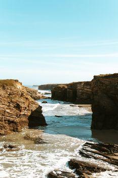 An amazing beach near the cliffs of Spain