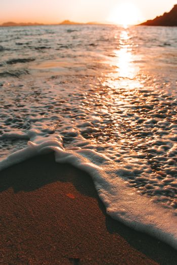 A close up to a textured tide over the sand