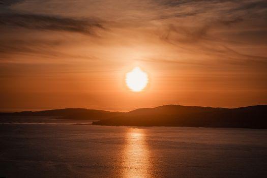 A giant sun over the Spanish coast