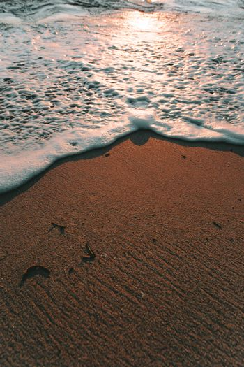 Minimalistic shot composed of half of tide and half of sand