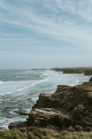 Spanish cliffs with giant waves crashing to them