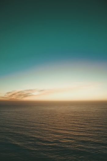 Yellow and blue gradient in the horizon with half of sea and half of sky