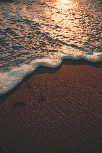A super sharp tide over the sand of a beach