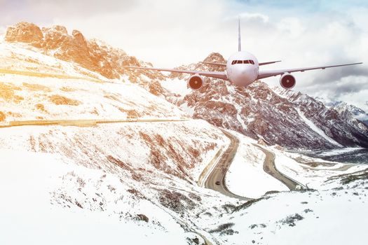 Airplane frying over the Snow Mountain background