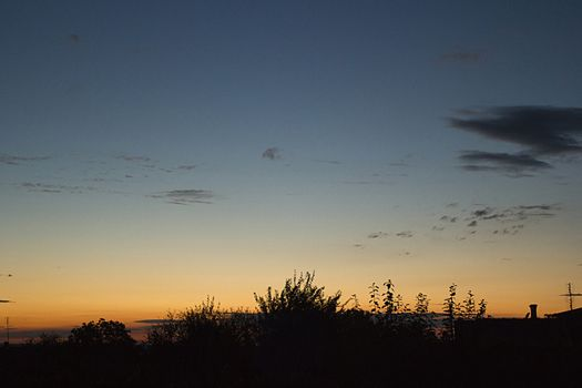 Summer early sunrise sunset over the village