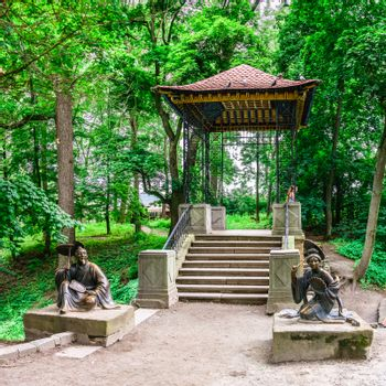 Bila Tserkva, Ukraine 06.20.2020. Chinese bridge in the Alexandria park, one of the most beautiful and famous arboretums in Ukraine, on a cloudy summer day.