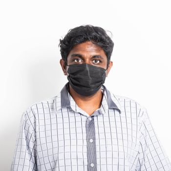Asian happy portrait young black man wearing face mask protective from virus coronavirus epidemic or air pollution looking camera, studio shot isolated on white background, stop COVID-19 concept