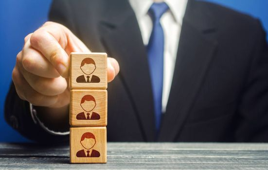Business leader builds a tower block with employees. Team building, hierarchical power vertical system. Leadership. Effective team Management. Company organization. Hiring and recruiting workers