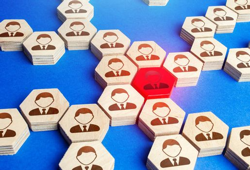 Red figurine of an employee in a big business company structure. Toxic and unreliable worker, bad influence. Leadership, teamwork. Staff relationships. Founder of the company, uniting around idea.