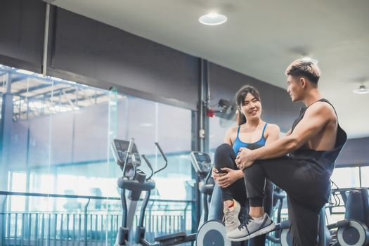 Asian couples exercise before running on the treadmill.Athletic exercises.Metaphor Fitness and workout concept exercise Health lifestyle muscle body with take care of your health