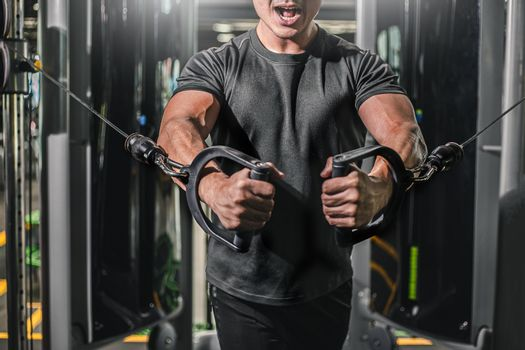 Asian men exercise chest workout on bench press cable machine lifestyle of man for fitness Health.Metaphor Fitness and workout concept exercise Health lifestyle muscle body your health