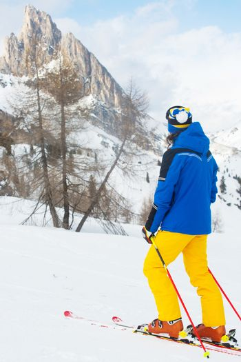 Skier with looking at mountain landscape