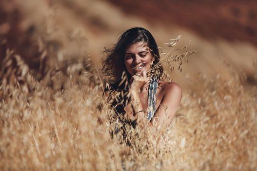 Cheerful Female in Wheat Field