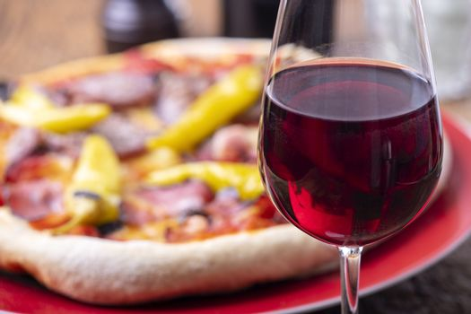red wine and a fresh pizza