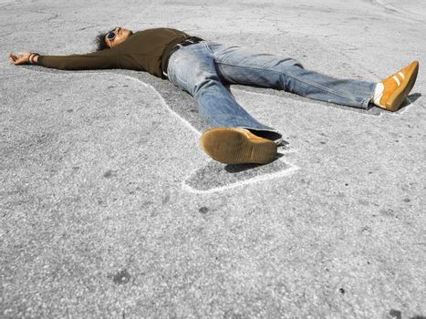 Chalk outline around dead victim lying in street