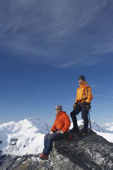 Mountain climbers on mountain peak