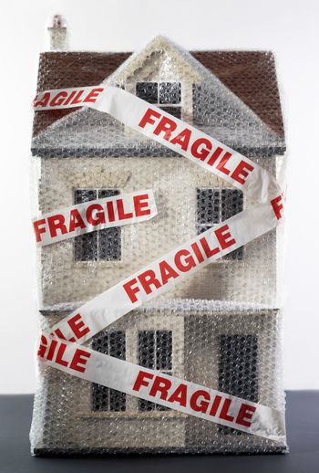 Model of house wrapped in bubble wrap and tape