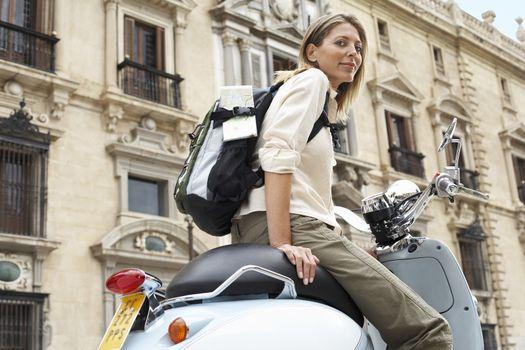 Tourist on scooter on street in Granada Spain