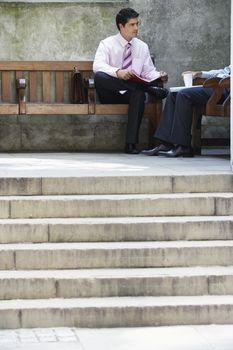 Two businessmen in outdoor meeting