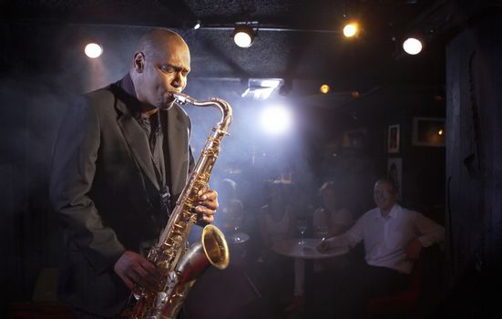 Portrait of Saxophone player on stage portrait
