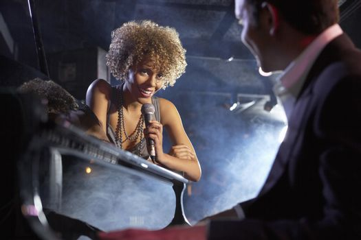 Jazz singer and pianist on stage low angle view