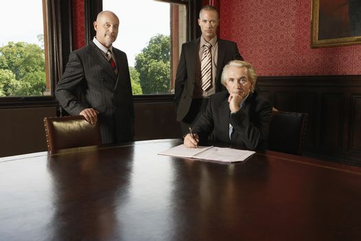 Portrait of Three businessmen in boardroom