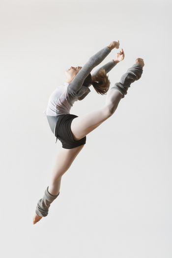 Portrait of Ballerina Leaping in Mid-air
