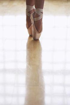 Close up of ballerina dancing in studio
