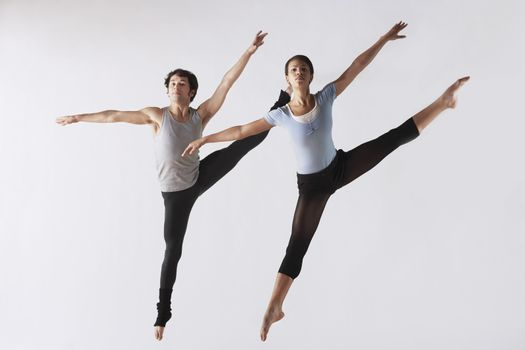 Leaping Ballet Dancers in Mid-air