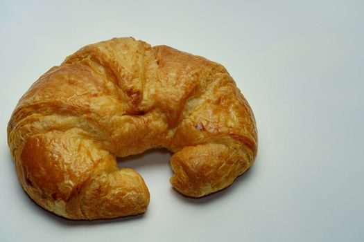One-piece plain croissant on the white background copy space.