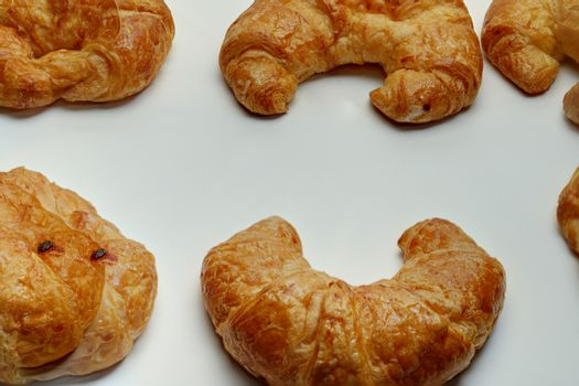Many plain croissants on the white background copy space.