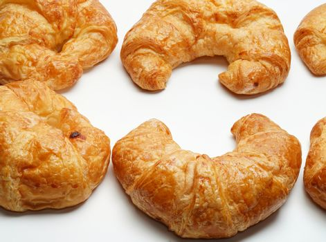 Many plain croissants on the white background copy space