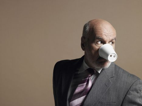 Businessman Wearing Plastic Cup as Pig Snout