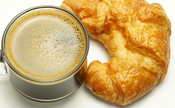 Breakfast, black coffee cup, a croissant is placed beside White background.
