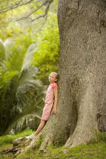 Girl Standing by Large Tree