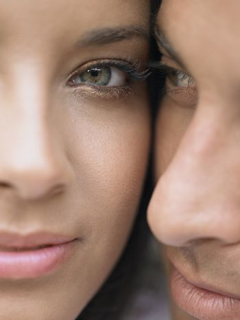 Portrait of young couple standing Cheek to Cheek