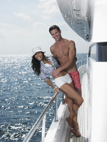 Young couple posing on yacht