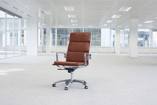 Swivel chair in empty office space