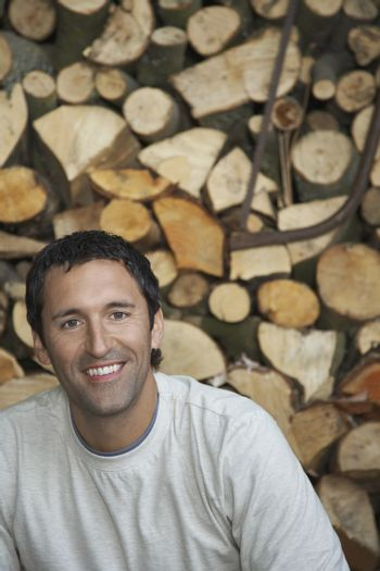 Man by timber shed portrait