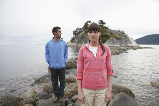 Couple standing on rocks at ocean