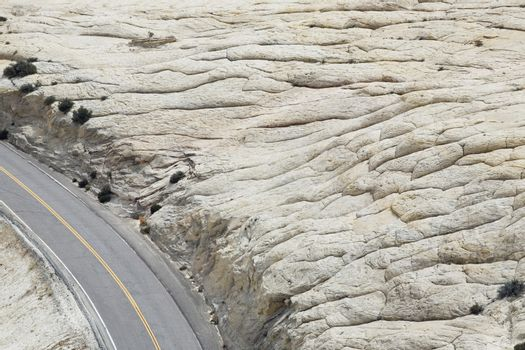 Road through rock formation in desert elevated view