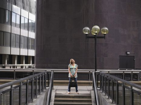 Woman standing at top of stairs
