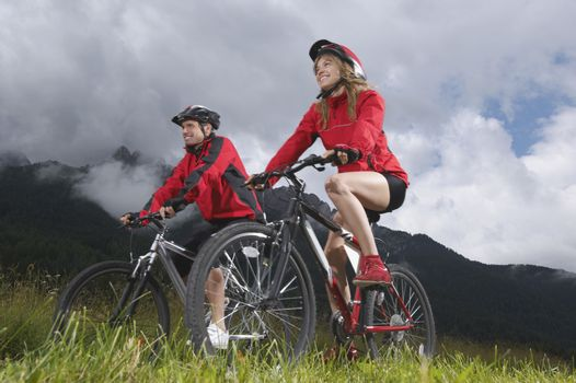 Portrait of Couple cycling in countryside