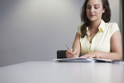 Woman sitting at desk and writing