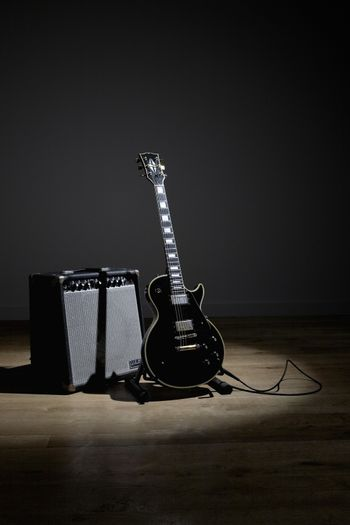 Electric guitar and amplifier on stage