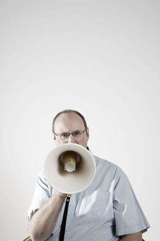 Portrait of Man talking through megaphone