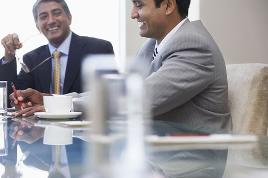 Business associates laughing on business meeting